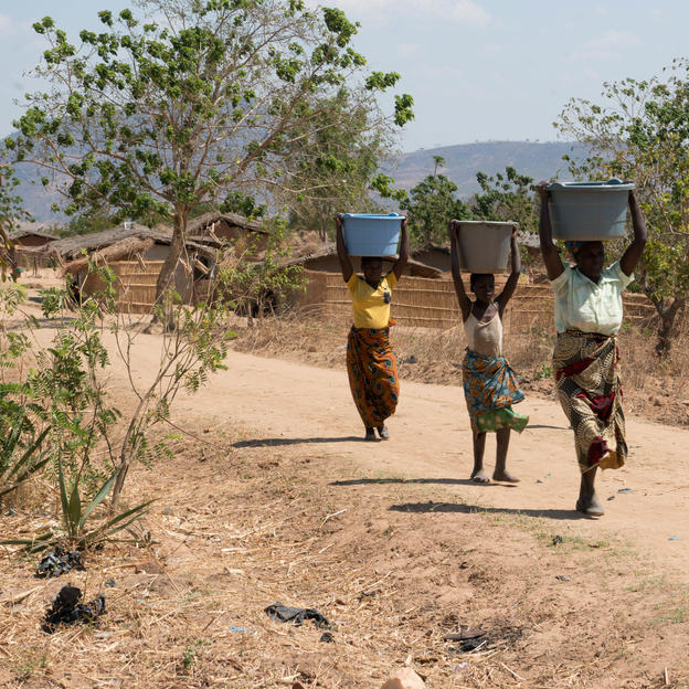 Maggie and her collegues on their way home with potable water in Vimphere village,Malawi.